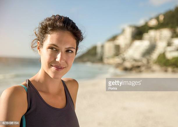 Thoughtful female athlete at beach