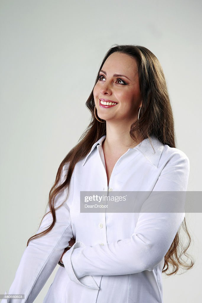 Thoughtful happy woman standing : Stock Photo