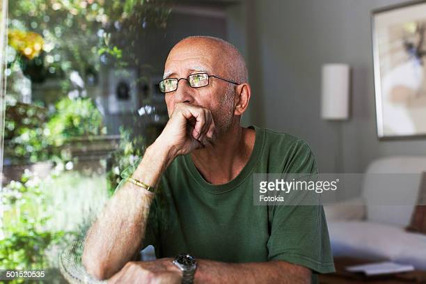 Thoughtful Man at Window