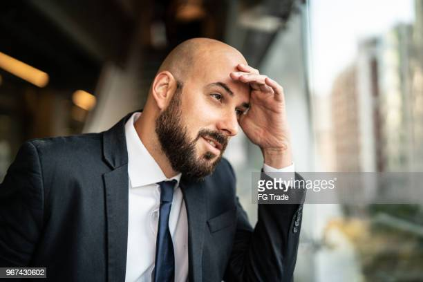 thoughtful man looking away - brazilian men stock photos and pictures