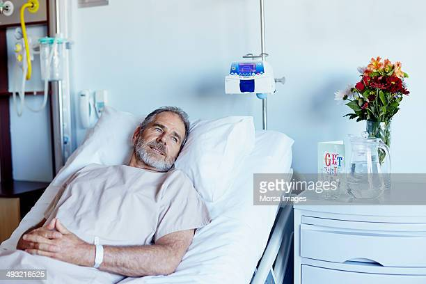 Thoughtful man relaxing in hospital ward