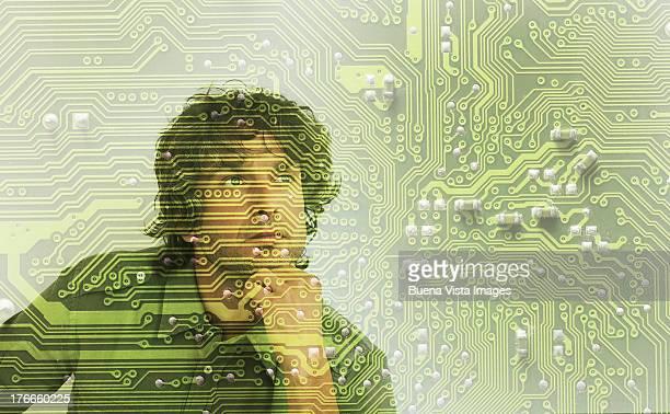 thoughtful man through a circuit board