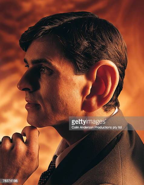 thoughtful man with large ear - earlobe stock photos and pictures
