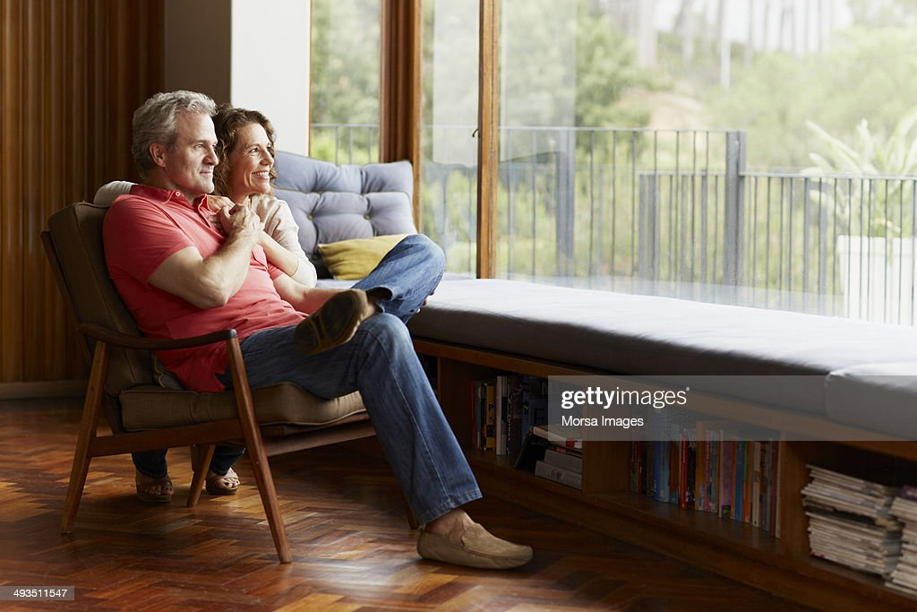 Thoughtful mature couple at home : Stock Photo