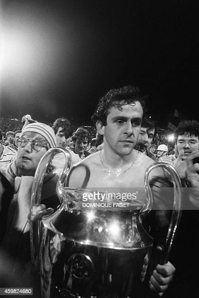 A thoughtful Michel Platini holds the cup on May 29 1985 after the Juventus victory on Liverpool at European Champion Clubs final at the Heysel...