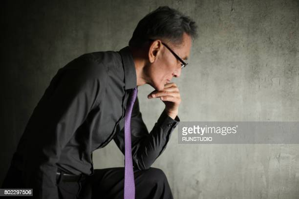 Thoughtful middle- aged man's portrait