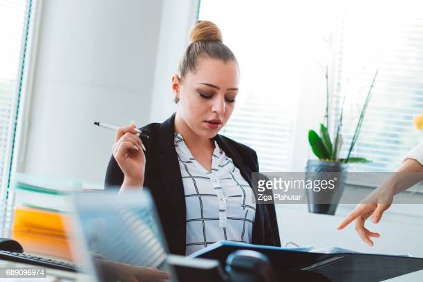 Thoughtful office manager checking finances