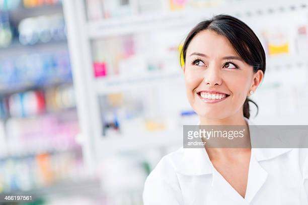 Thoughtful pharmacist at the drugstore