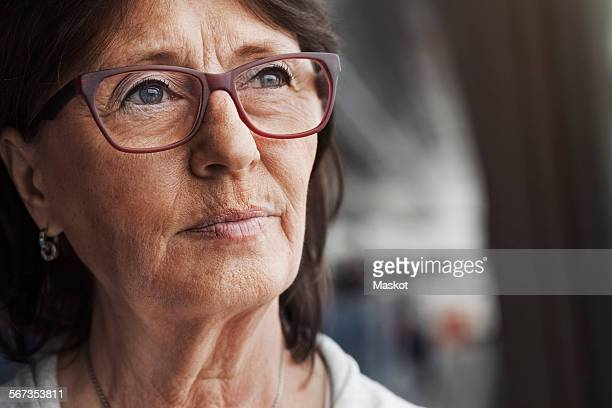 Thoughtful senior businesswoman looking away in office