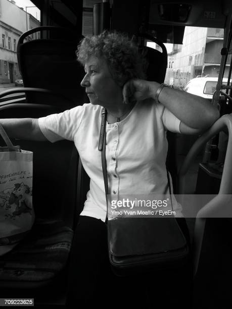 Thoughtful Senior Woman Sitting In Tram
