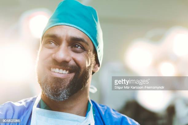Thoughtful smiling doctor in hospital