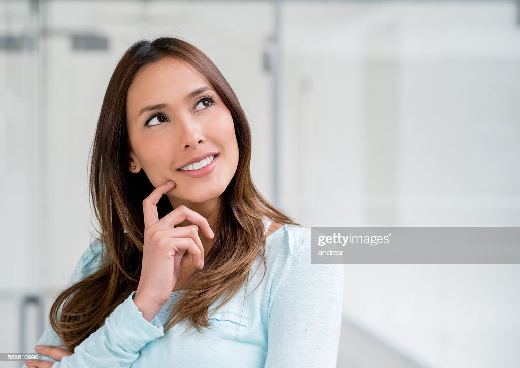 Thoughtful woman at a shopping center : Stock Photo