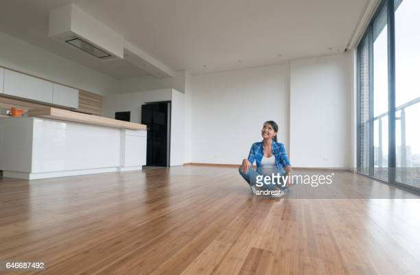thoughtful woman at an empty apartment - interior design foto e immagini stock