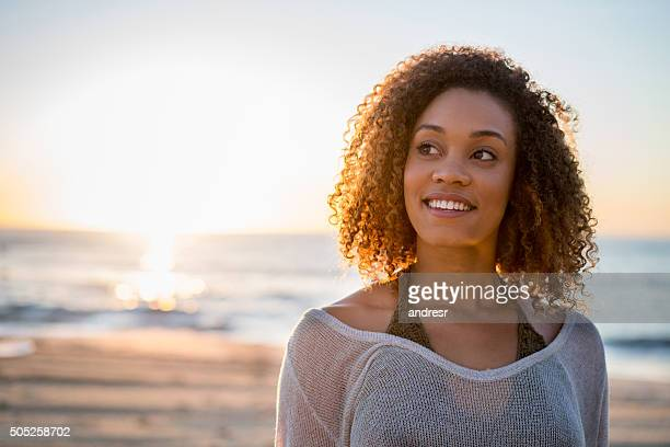 Thoughtful woman at the beach