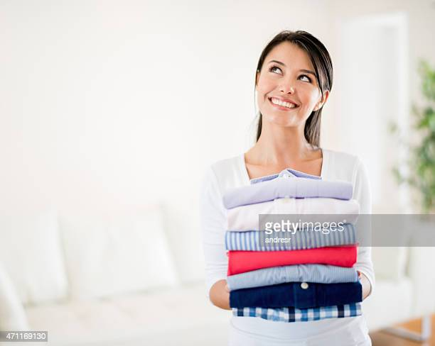 Thoughtful woman doing the laundry