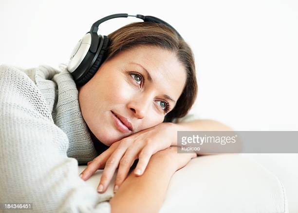 Thoughtful woman enjoying music