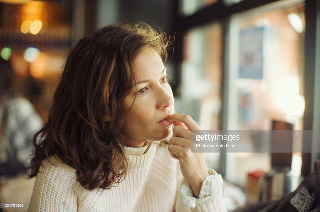 Thoughtful woman in bar : Stock Photo