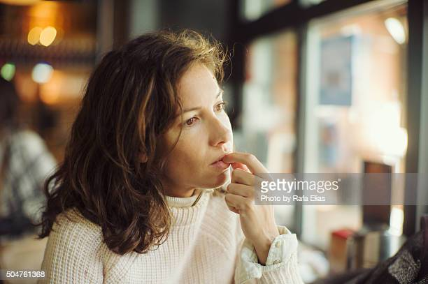 Thoughtful woman in bar