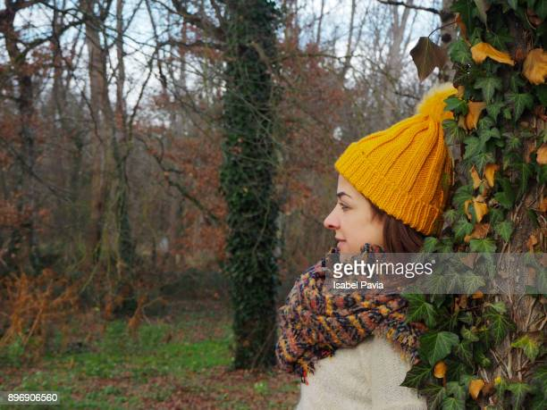 Thoughtful Woman Leaning On Tree