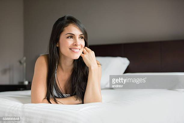 Thoughtful woman lying in bed