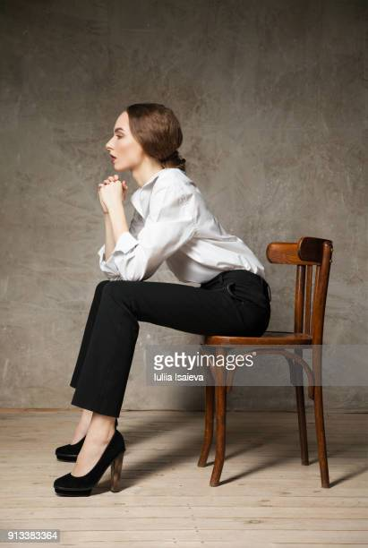 Thoughtful woman on chair