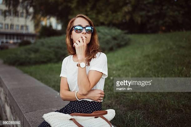 Thoughtful woman outside