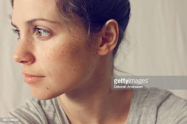 thoughtful woman - freckle stock pictures, royalty-free photos & images