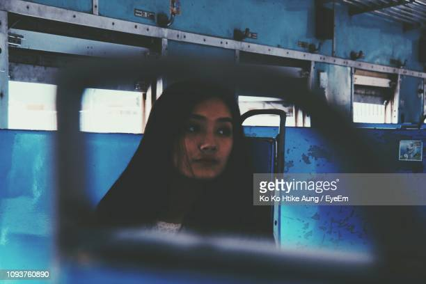 thoughtful woman sitting in train - ko ko htike aung stock pictures, royalty-free photos & images