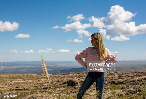 thoughtful woman standing on mountain against blue sky - cordoba argentina stock photos and pictures