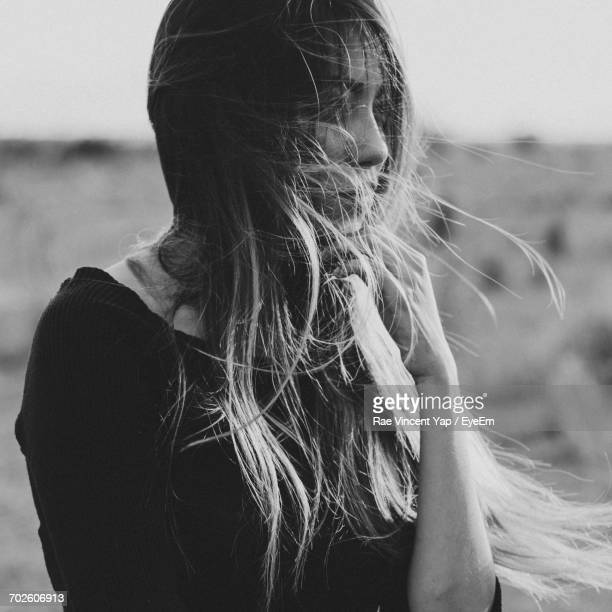 Thoughtful Woman With Tousled Hair Looking Away
