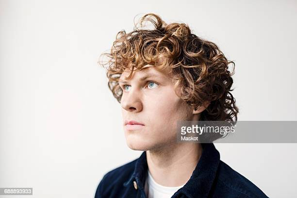 Thoughtful young man against white background
