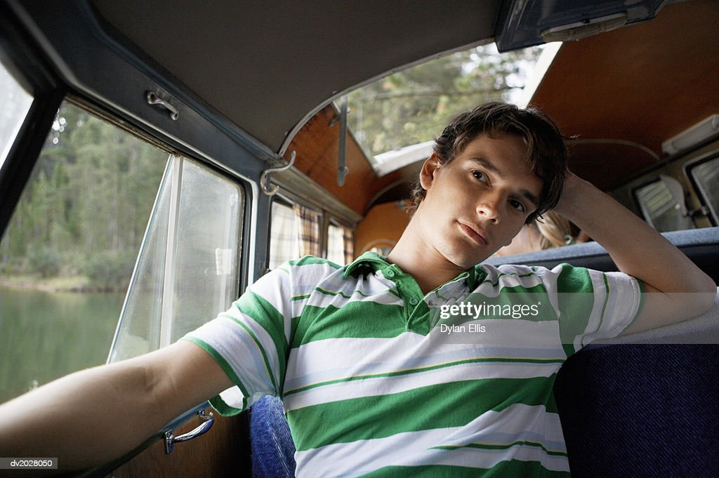 Thoughtful, Young Man Sitting in a Motor Home : Stock Photo