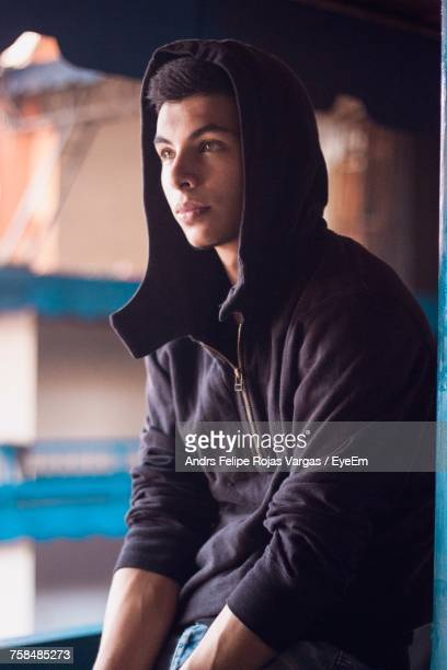 Thoughtful Young Man Wearing Hooded Shirt While Looking Away