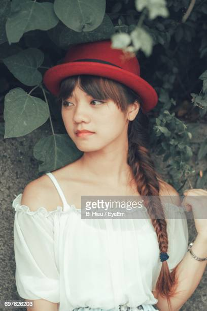 Thoughtful Young Woman In Hat Looking Away
