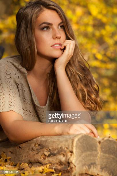 Thoughtful young woman outdoors in autumn