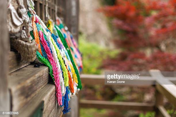 A thousand colourful mini Origami paper cranes hanging outside a temple in Yamadera To make wishes come true