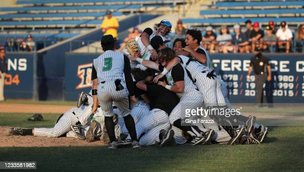 Thousand Oaks celebrates their 3-2 win over Trabuco Hills in the CIF Southern Section Division 2 Championship at Cal State Fullerton on June 19, 2021...