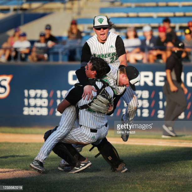 Thousand Oaks first baseman Dylan Jackson and catcher Charlie Saum surround starting pitcher Myles Weiss after the Lancers beat Trabuco Hills 3-2 in...