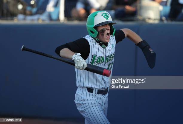 Thousand Oaks Peyton Miller reacts after scoring the tying run against Trabuco Hills in the fifth inning of the CIF Southern Section Division 2...