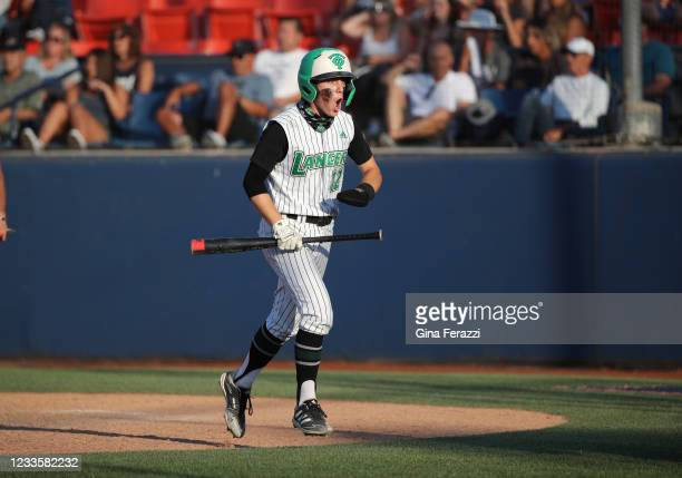 Thousand Oaks Peyton Miller reacts after scoring the tying run against Trabuco Hillsin the fifth inning of the CIF Southern Section Division 2...