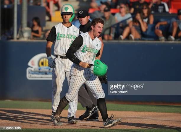 Thousand Oaks Roc Riggio reacts after scoring the go-ahead run on a wild pitch run against Trabuco Hills in the fifth inning of the CIF Southern...