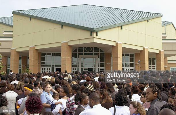Thousand of fans wait in line to attend the public funeral of singer Lisa Left Eye Lopes at the New Birth Missionary Baptist Church May 2 2002 in...