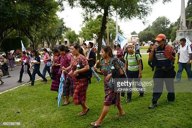 Thousand of farmers and natives of the municipality of San Juan Sacatepequez take part a march in Guatemala City protesting against of the presence...