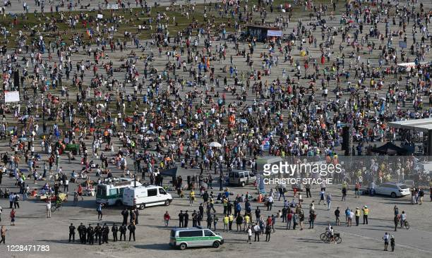 Thousand of people take part at a demonstration against the coronavirus Covid-19 restrictions at the Theresienwiese in Munich, southern Germany, on...