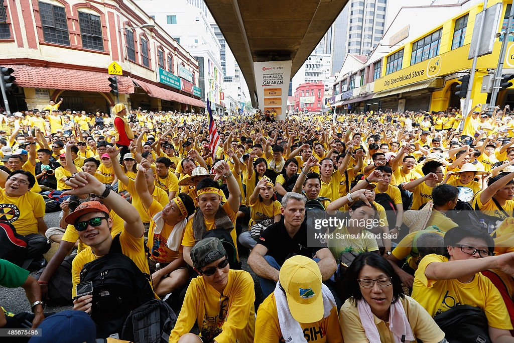 Thousand of protesters seat as they listen a speech during a Bersih (Clean) rally as protestors call for the resignation of Prime Minister Najib Razak on August 29, 2015 in Kuala Lumpur, Malaysia. Prime Minister Najib Razak has become embroiled in a scandal involving state fund debts and allegations of deposits totaling 2.6 billion ringgit paid to his bank account. Razak has denied any wrongdoing. Thousand of people gathered to demand his resignation and a new general election.