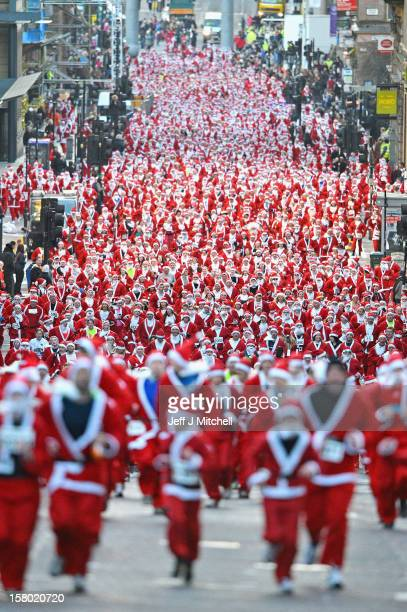 A thousand people take part in the annual Glasgow Santa Dash on November 9 2012 in Glasgow Scotland Members of the public dressed in Santa suits took...