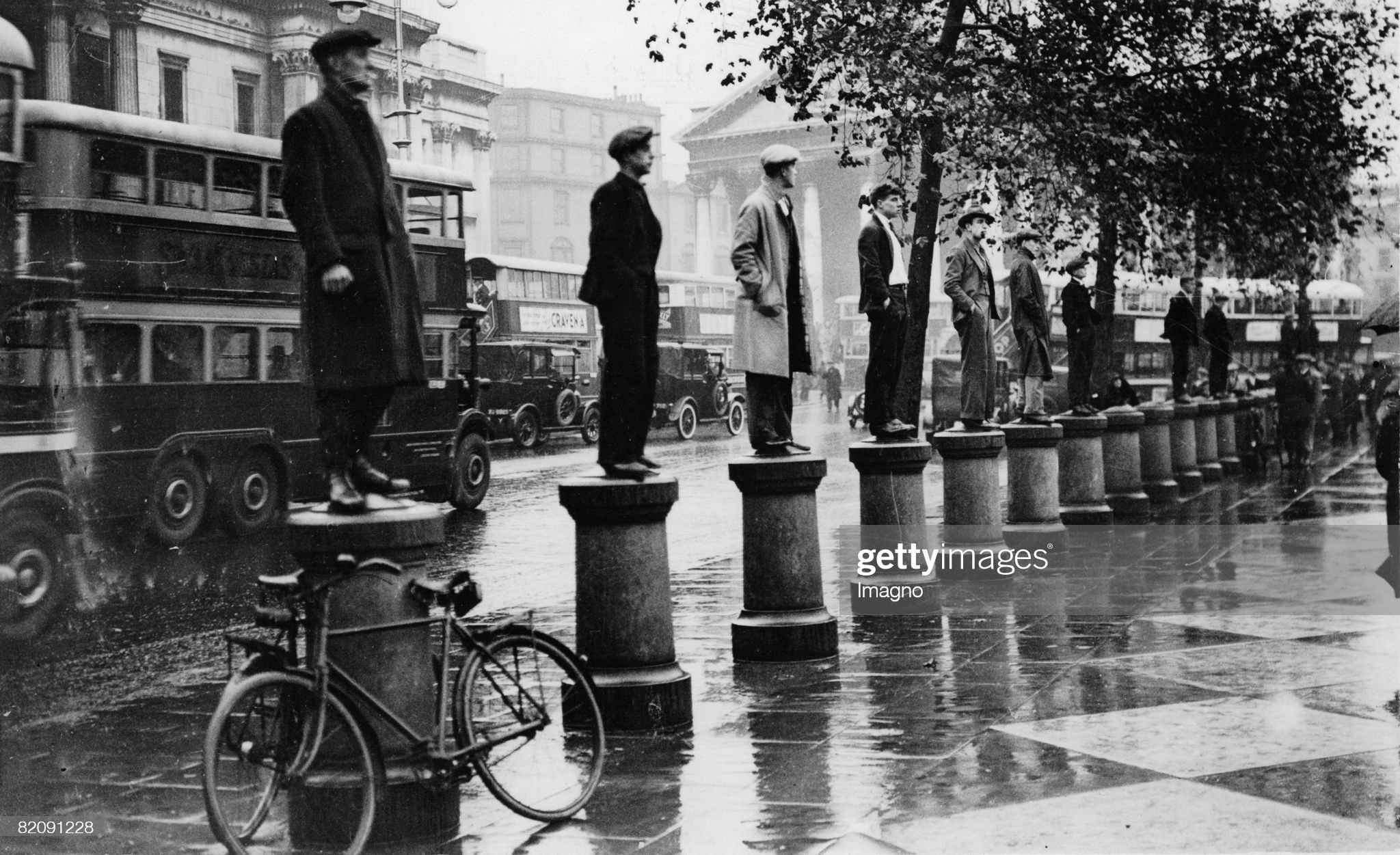 Thousand unemployed people demonstrating in London, Some man standing on collumns at Trafalgar Square, England, Photograph, October 31st 1932 : News Photo