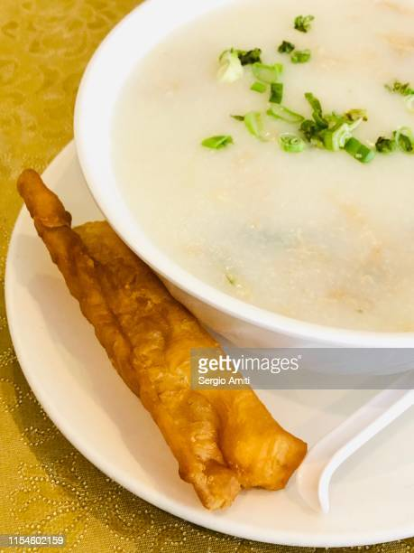 thousand year egg and pork congee with youtiao - congee stock photos and pictures