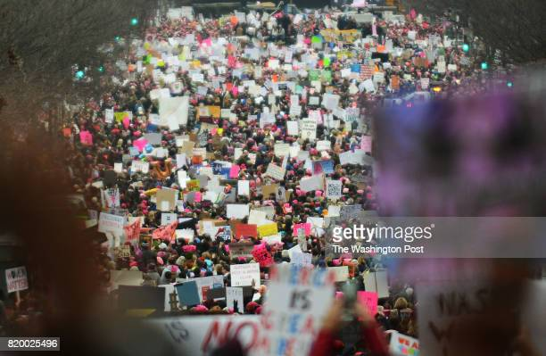 Thousands already march as early as 1030 am down 7th Street Northwest to reach the National Mall near the US Capitol in Washington DC January 21 for...