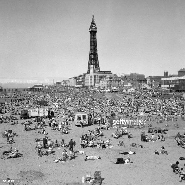 Thousands crowd the sands of the Blackpool Pleasure beach during the hot weather
